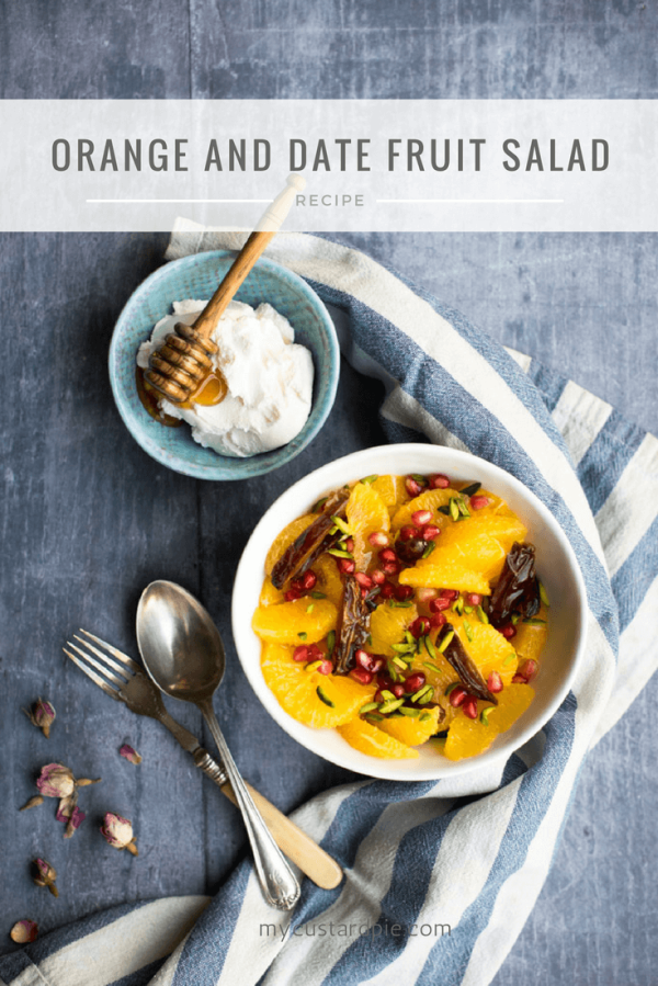 Orange and date salad with a bowl of yoghurt and some cutlery