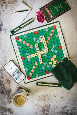 Scrabble board, cup of tea, phone