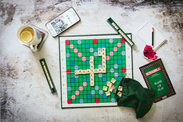 Scrabble game, cup of tea and phone