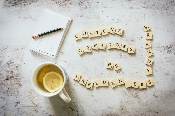 Scrabble letters, a cup of tea and a notepad