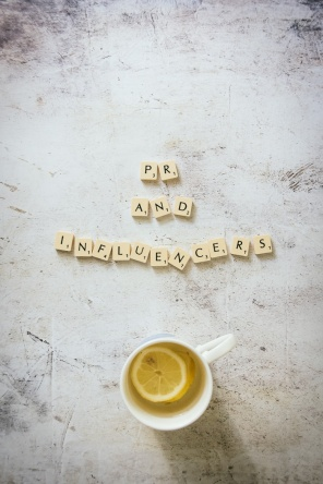 Scrabble letters and a cup of tea