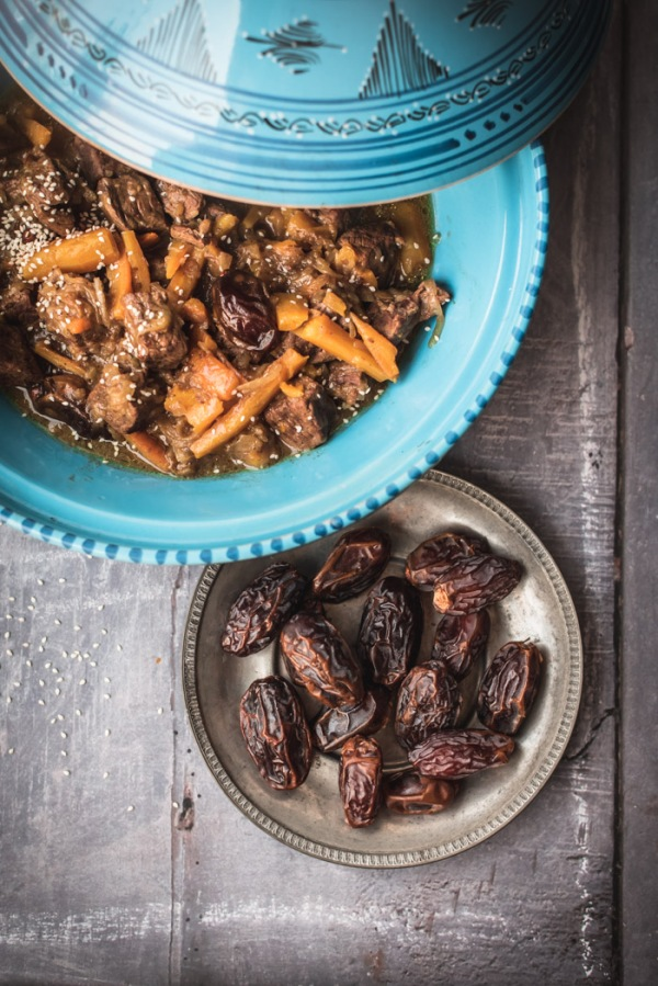 Beef, dates and carrots in a tagine with a plate of dates