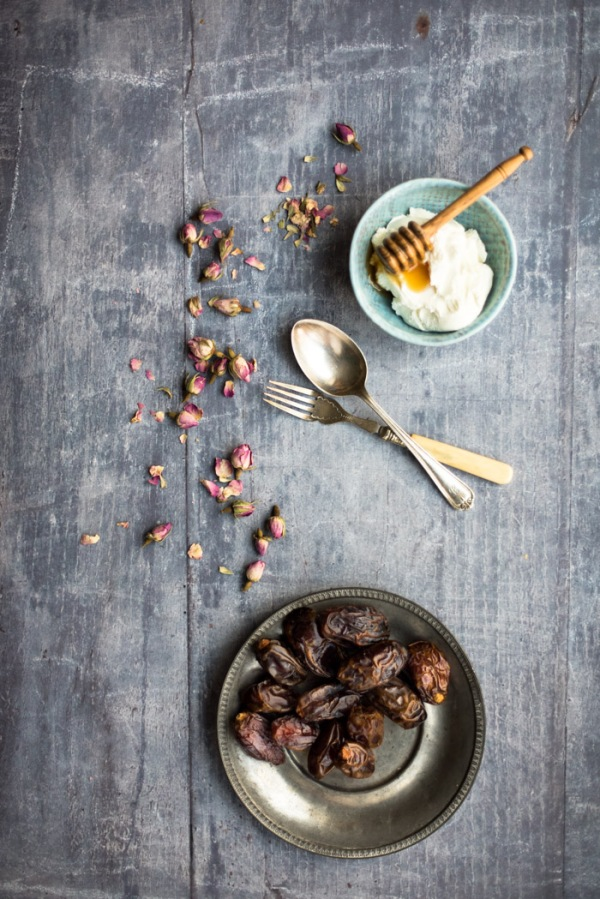 Bowl of yoghurt and a plate of dates