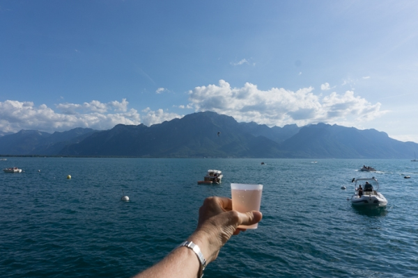 glass of rose wine and lake geneva