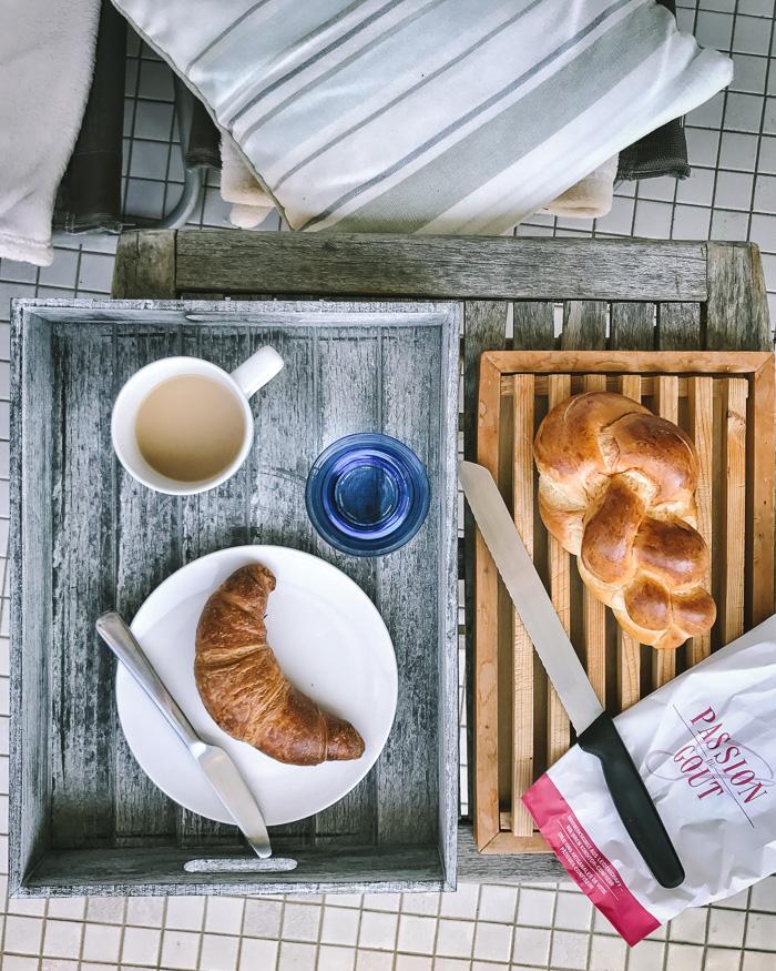 crossant, tea and bread