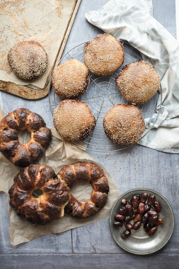 A variety of date breads and a plate of dates