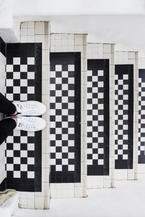 feet on black and white stairs