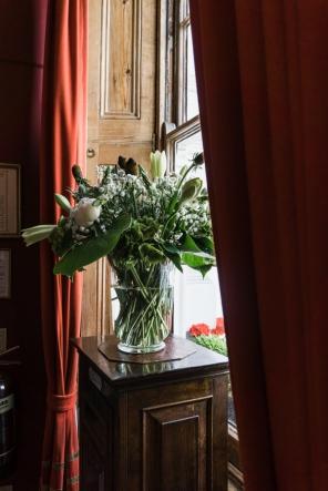 bunch of flowers in a window