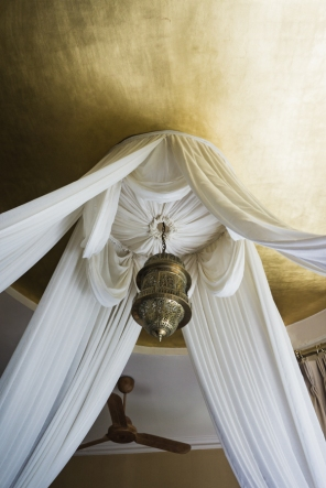 gold ceiling with drapes and light