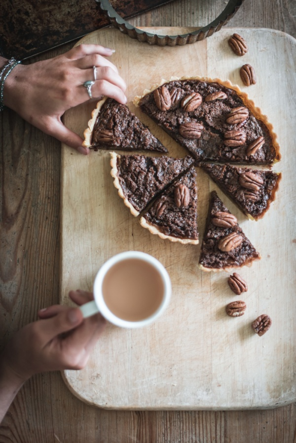 mock pecan pie and a cup of tea with hands