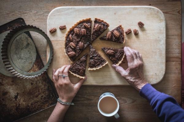 hands reaching in for slices of mock pecan pie