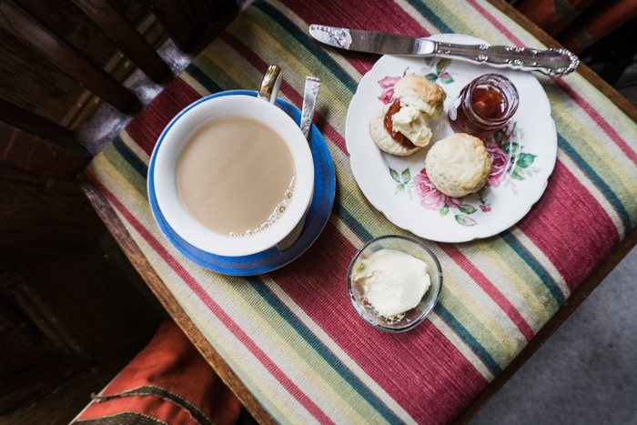 tea and scones on a striped chair