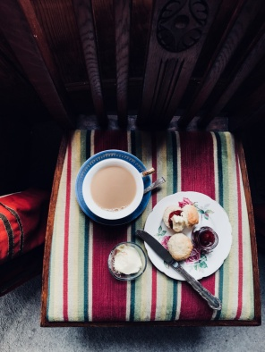 tea and scones on a chair