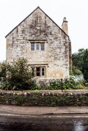 Cotswold stone house in the rain
