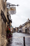 Sign for the Lion Inn on a street in Winchcombe