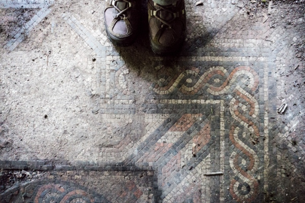 Walking boots by a Roman mosaic