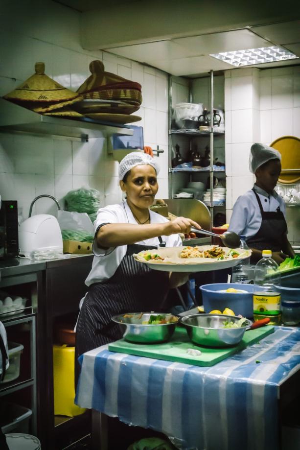 a cook in an Ethiopian restaurant kitchen in Dubai