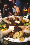 Ethiopian food being eaten with hands