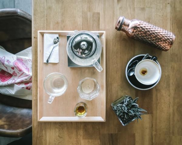 a tea tray and a reusable bottle