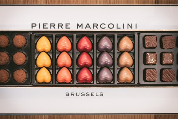 A large box with drawers of A box of Pierre Marcolini chocolates showing heart-shaped ones