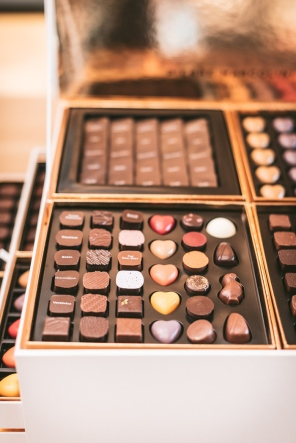 A large box with drawers of Pierre Marcolini chocolates