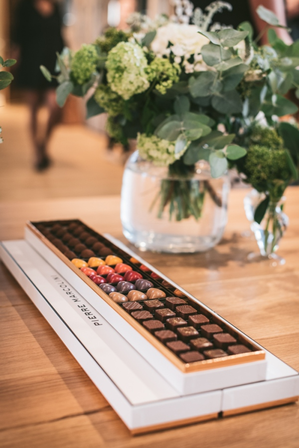 A box of Pierre Marcolini chocolates and a vase