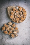 gingerbread biscuits on a wooden board and cooling rack
