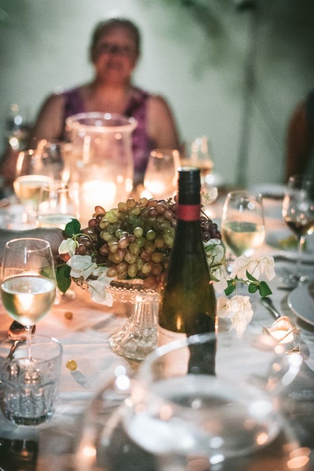 Table in the garden with lots of wine glasses