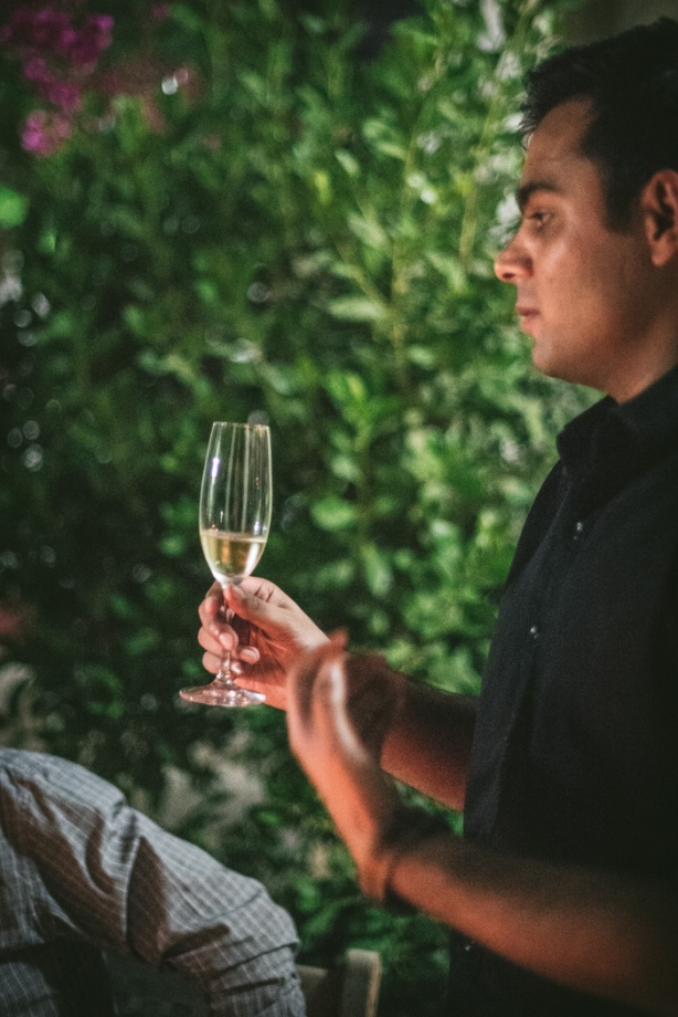 sommelier holds glass of wine