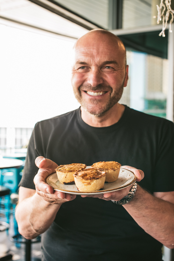 Simon Rimmer holding pies