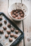 Dipping Tim Tam Truffles into melted chocolate