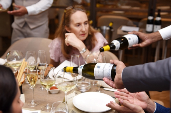 Olivier Leflaive white Burgundy being poured into glasses at Il Borro restaurant