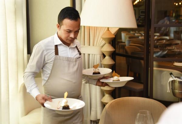 waiter holding plates