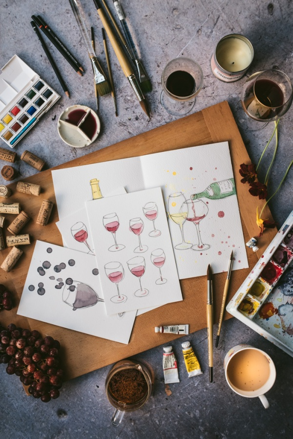 paintings of wine on an artists board