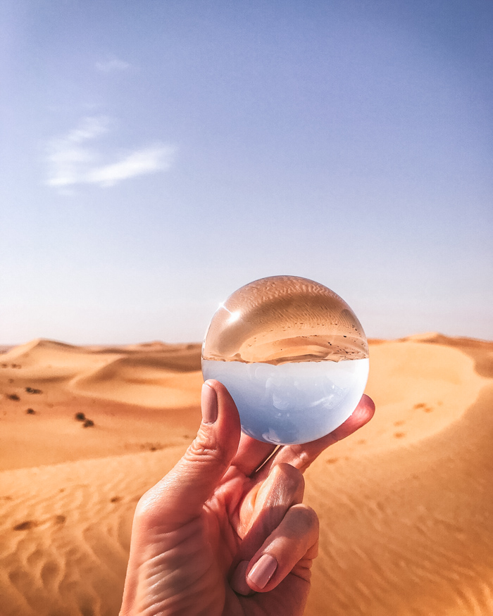 a lensball reflecting the desert
