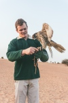 a falcon being fed