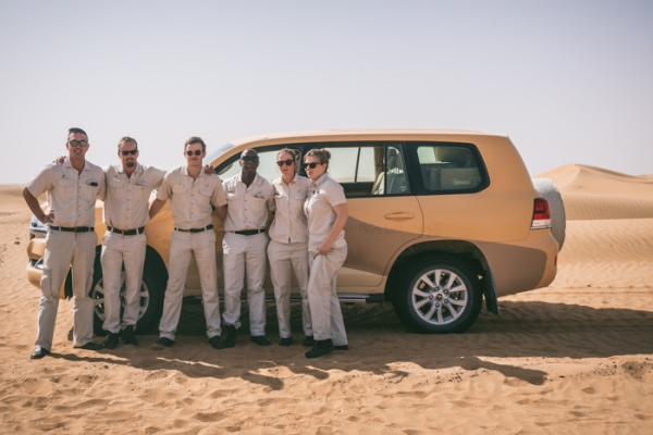 rangers in the desert in front of four wheel drives