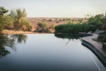 The view over private infinity pool into the desert