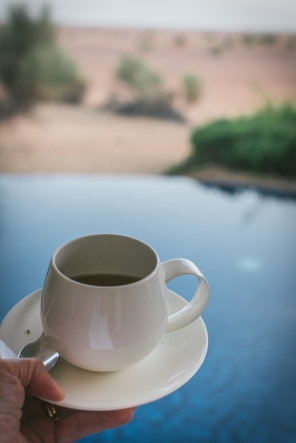 cup of tea with pool in background