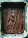 brownie mix in a baking tin levelled out