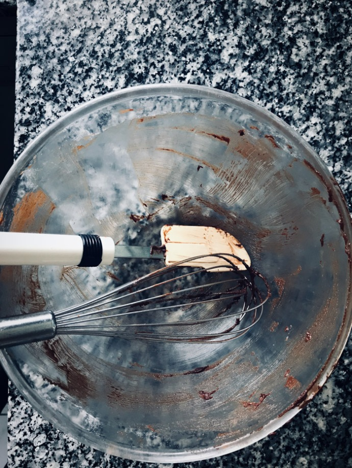 Empty mixing bowl with some traces of cake mixture