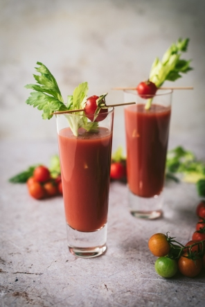 glasses of Bloody Mary and lots of tomatoes