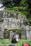 boy sketching gravestones