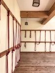 Yoga studio with ropes hanging from the walls