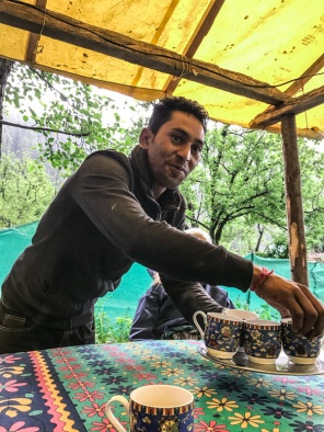 Man serving chai