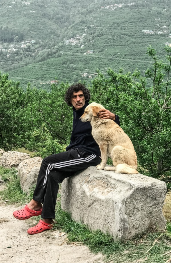 Our yoga teacher and his adopted dog