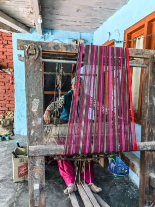 woman weaving at loom