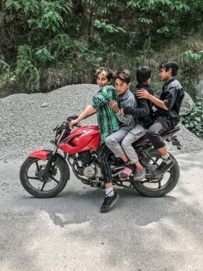 four boys on a motorbik