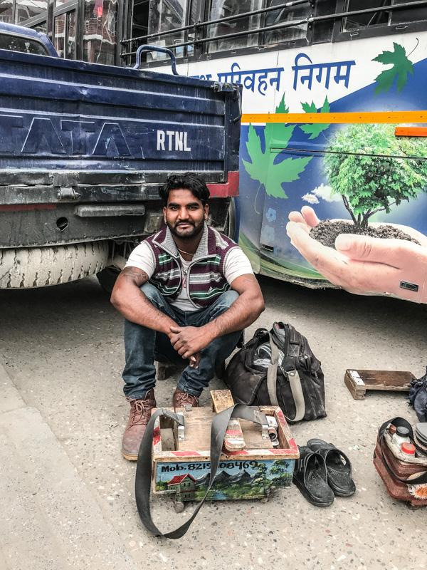 man and shoe shine kit