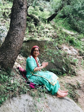Lady sitting under a tree